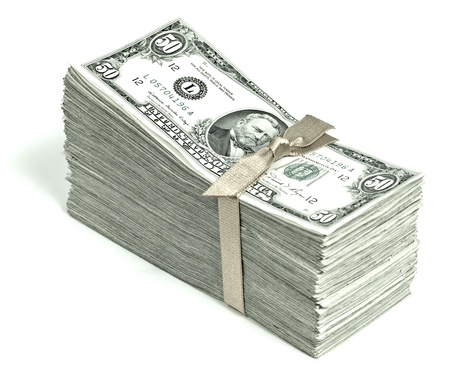 Stack of United States Currency Tied in a Ribbon - Fifties Stock Photo