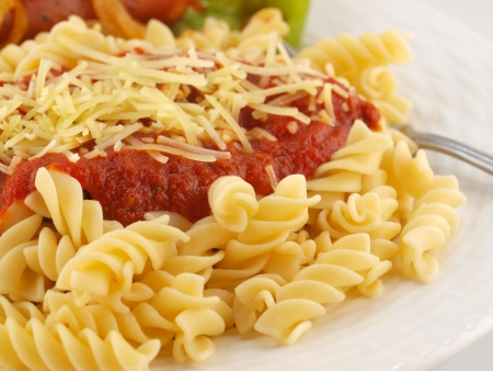 rotini: Rotini Pasta with Tomato Sauce, Cheese, and Sausage with Peppers and Onions     Stock Photo