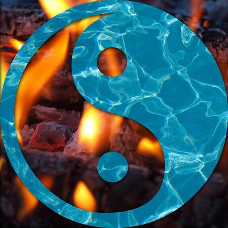 Water and Flames in a Yin and Yang Symbol Opposites Concept Stock Photo