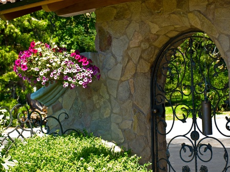 Wrought Iron Garden Gate in a Fancy Garden Stock Photo - 10754523