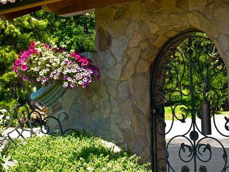 Wrought Iron Garden Gate in a Fancy Garden Stock Photo - 10754523