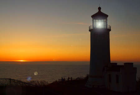 Light Shining in the North Head Lighthouse on the Washington Coast at Sunset Stock Photo - 10754354