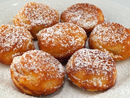 A Plate of Freshly Made Aebelskivers with Powdered Sugar Stock Photo - 10754372