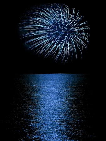 Long Exposure of Fireworks Reflecting on Calm Rippling Water Stock Photo - 11075317