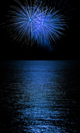 Long Exposure of Fireworks Reflecting on Calm Rippling Water Stock Photo - 11075255