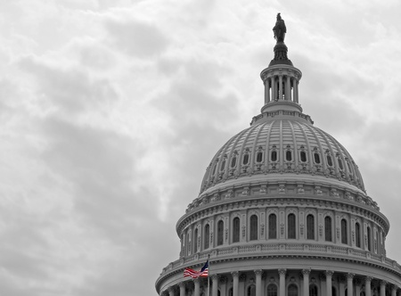 United States Capitol Building in Washington DC in Black & White and American Flag in Color Editoriali