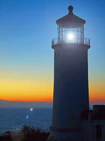 guiding light: Light Shining in the North Head Lighthouse on the Washington Coast at Sunset