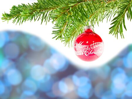 Blue Bokeh Abstract Background with Red Christmas Ornament Hanging from a Branch Stockfoto