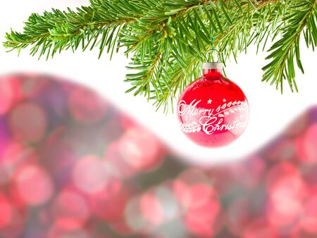 Red Bokeh Abstract Background with Red Christmas Ornament Hanging from a Branch