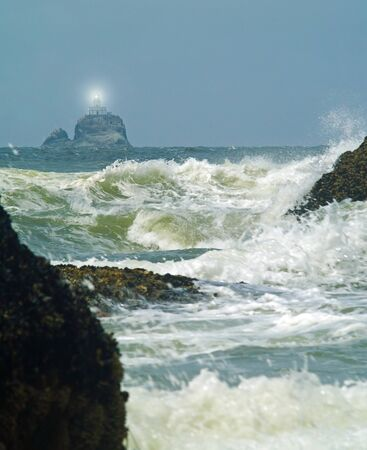 Terrible Tilly Lighthouse on Oregon Coast with Light Shining photo