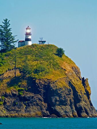 Lighthouse at Cape Disappointment at Fort Canby State Park in WA USA with Light