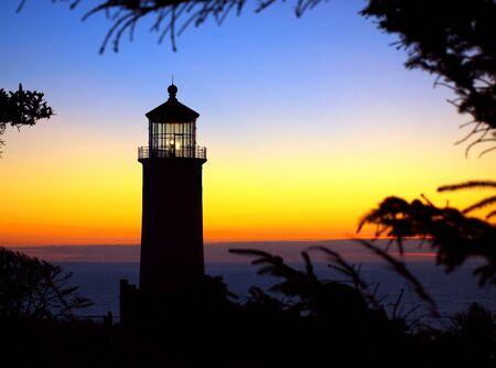 guiding light: Light Shining in the North Head Lighthouse on the Washington Coast at Sunset  Stock Photo