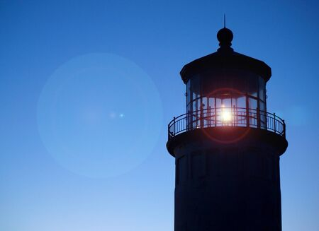Light Shining in the North Head Lighthouse on the Washington Coast at Sunset  photo