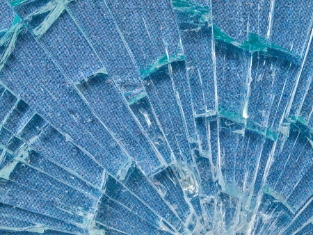Cracked Glass Macro with a Sky Blue Patterned Background Stock Photo - 14450364