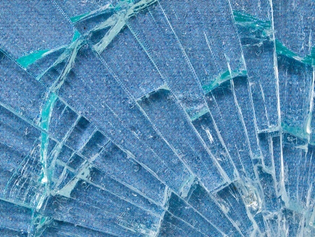 sabotage: Cracked Glass Macro with a Sky Blue Patterned Background Stock Photo