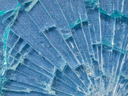 Cracked Glass Macro with a Sky Blue Patterned Background Stock Photo