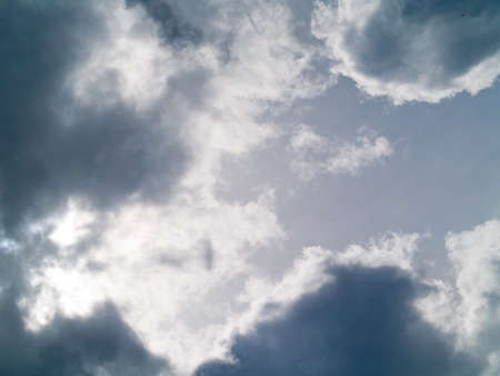 White and gray clouds in a pale sky Stock Photo