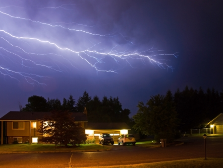 Lightning Flashes Across a Stormy Night Sky photo