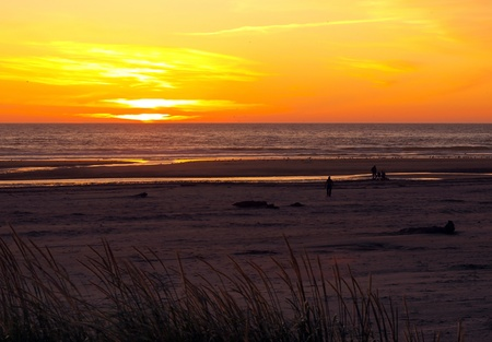 hirtshals: Bright Orange and Golden Sunset with a Family at the Beach
