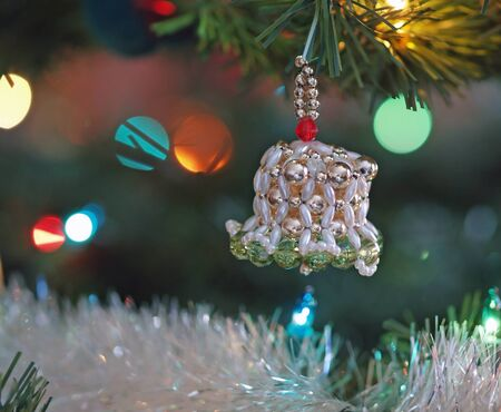 Christmas Ornaments on a Green Tree photo