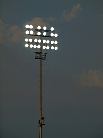 Stadium Lights Against an Evening Sky at Dusk photo