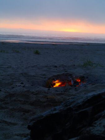 broiling: Beach Campfire at Dusk with Ocean in the background