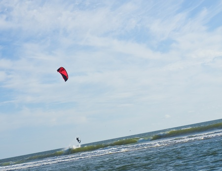 Kite Surfer out on the Ocean on a Sunny Day photo