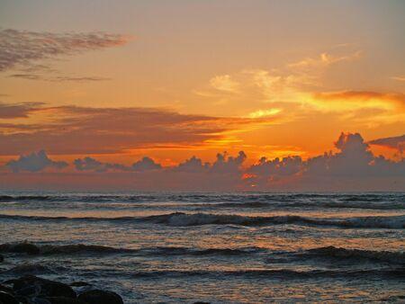 Fiery Sunset at a Rocky Beach on the Oregon Coast photo