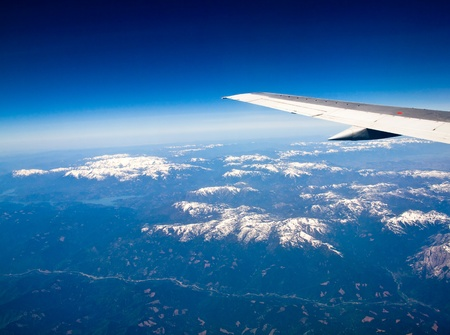 View of a Snowcapped Mountain Landscape from an Airplane photo