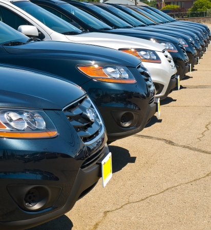 Row of Automobiles on a Car Lot on a Bright Sunny Day Stock Photo