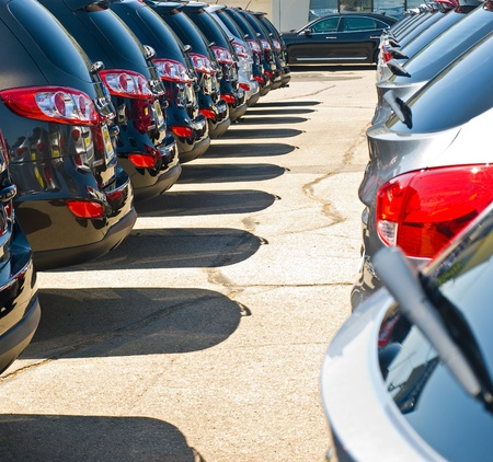 automobile dealership: Row of Automobiles on a Car Lot on a Bright Sunny Day Stock Photo