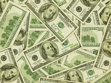 A Pile of Hundred Dollar Bills as a Money Background photo