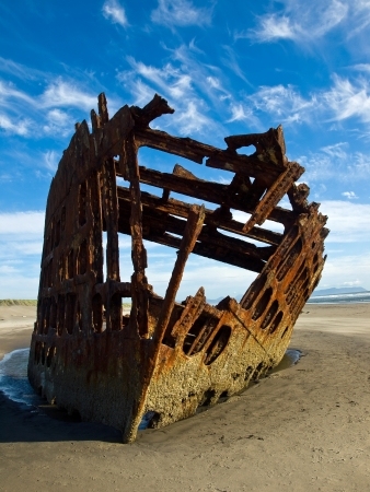 Rusty Wreckage of a Ship on a Beach on the Oregon Coast USA photo