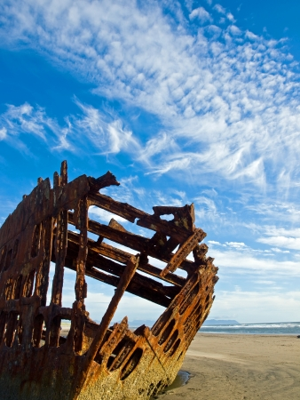 Rusty Wreckage of a Ship on a Beach on the Oregon Coast USA photo