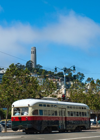 coit: Coit Tower and Trolley in San Francisco California USA