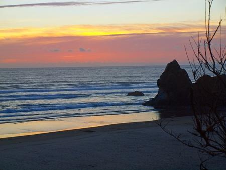 arcadia: Colorful Sunset at Arcadia Beach on the Northern Oregon Coast USA Stock Photo