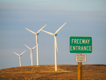 industrial park: Windmill Farm on a Mountain with Freeway Entrance Signs at Dusk