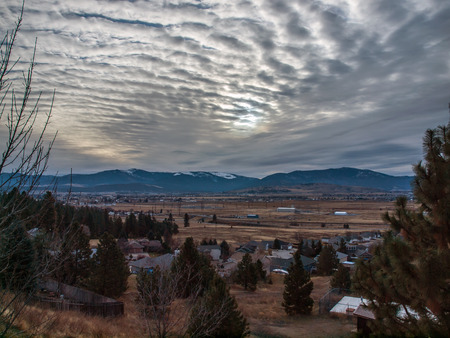 a rural community: A Rural Community in a Wide Valley on a Cloudy Day Stock Photo