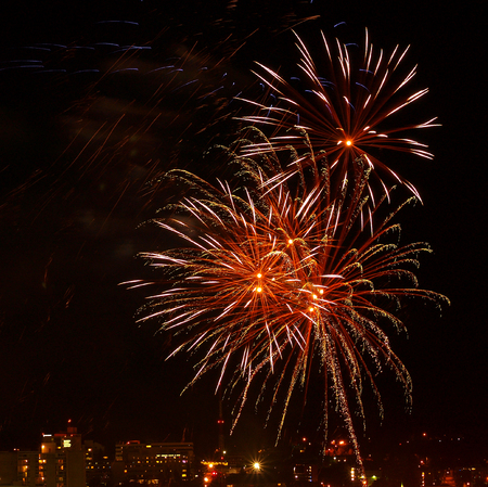 Fireworks Against the Night Sky of a Cityscape photo