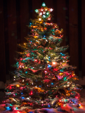 snow covered christmas tree with multi colored lights stock photo picture and royalty free image image 33176811