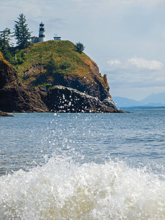 Cape Disappointment Lighthouse in Fort Canby State Park from Waikiki Beach near Ilwaco Washington USA Reklamní fotografie