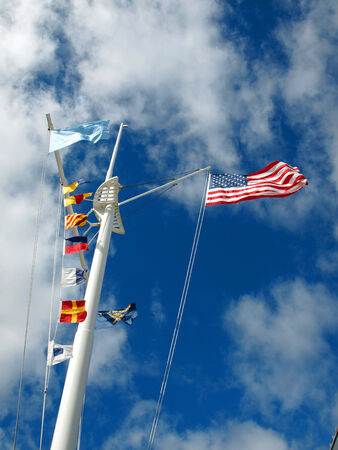 Nautical and American Flags Flying from a Ship photo