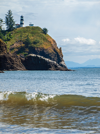 Cape Disappointment Lighthouse in Fort Canby State Park from Waikiki Beach near Ilwaco Washington USA Stock Photo