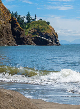 Cape Disappointment Lighthouse in Fort Canby State Park from Waikiki Beach near Ilwaco Washington USA photo