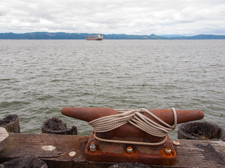 Large Harbor Mooring with Ropes on a Dock at Astoria Oregon USA photo