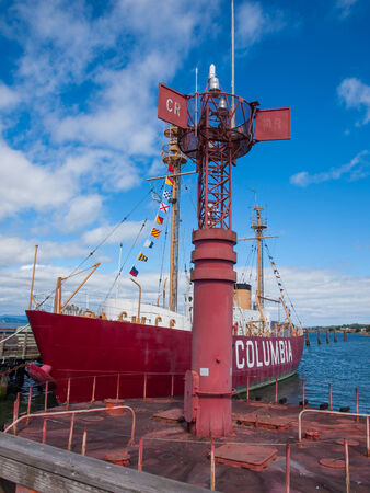 Columbia Lightship and Modern Navigational Buoy in Astoria Oregon USA on a Clear Day