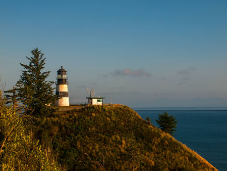 disappointment: Cape Disappointment Lighthouse at Sunset on the Washington Coast USA