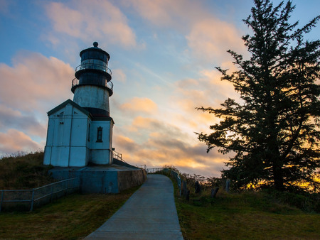 Cape Disappointment Lighthouse at Sunset in Fort Canby State Park near Ilwaco Washington USA Stock Photo