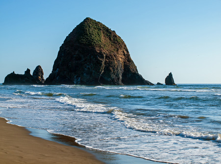 Haystack Rock and Gentle Waves at Cannon Beach Oregon USA photo