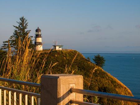Cape Disappointment Lighthouse at Sunset on the Washington Coast USA photo